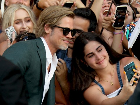Brad Pitt laps up the attention as he takes selfies with fans at Once Upon A Time In Hollywood premiere