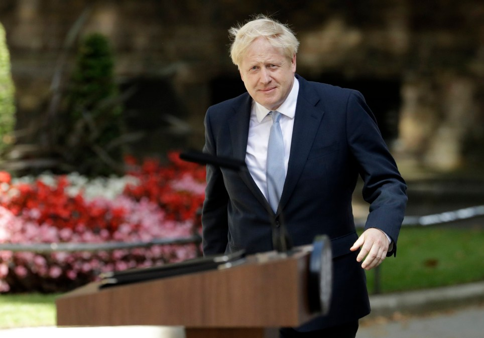 Britain's new Prime Minister Boris Johnson arrives to make a speech outside 10 Downing Street, London, Wednesday, July 24, 2019. Boris Johnson has replaced Theresa May as Prime Minister, following her resignation last month after Parliament repeatedly rejected the Brexit withdrawal agreement she struck with the European Union.