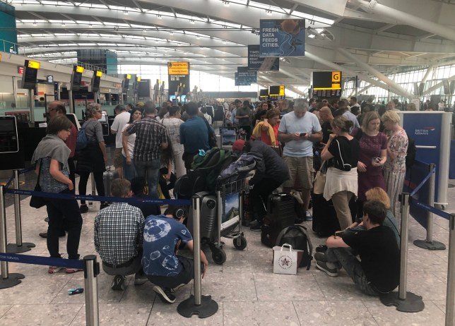 """Queues in Terminal 5 at Heathrow airport as the UK's biggest airport has apologised after extreme weather conditions across Europe caused flight cancellations and delays. PRESS ASSOCIATION Photo. Picture date: Friday July 26, 2019. Heathrow Airport is asking passengers to check with airlines before travelling, while Gatwick Airport issued the same advice, warning """"bad weather"""" may delay flights. See PA story WEATHER Hot . Photo credit should read: Steve Parsons/PA Wire"""