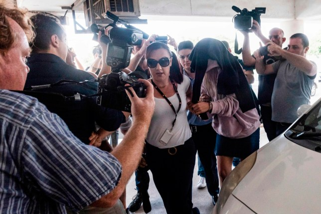 This picture taken on July 29, 2019 shows a British teenager who accused seven Israelis of gang rape arriving at the Famagusta District Court in Paralimni in eastern Cyprus, to face charges of making a false allegation