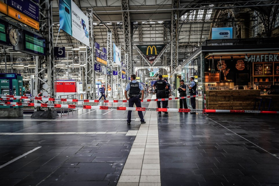 epa07747261 Police officers cordon off areas near the platforms at the main train station in Frankfurt am Main, Germany, 29 July 2019. Police say that a child has died after reportedly being pushed onto the tracks in front of a train. One person has been arrested. EPA/CARSTEN RIEDEL