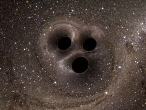 A trio of monster black holes are having a cosmic threesome and it's awesome to behold