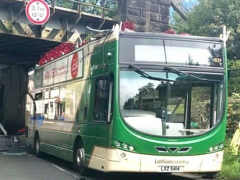 Roof ripped off double decker bus after it smashed into railway bridge