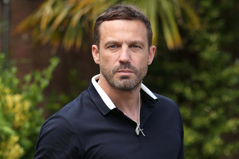 """(Picture: Lime Pictures) Jamie Lomas is confirmed to start filming later this year and says there?s """"unfinished business"""" for his character in Hollyoaks village. Warren Fox will make his full time return to Hollyoaks in 2020 as the show prepares to celebrate its 25th anniversary."""