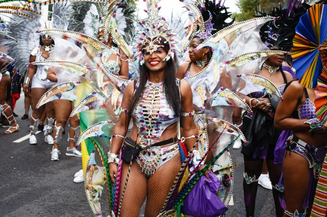 A party-goer dressed in a colourful carnival outfit during Notting Hill Carnival in 2018