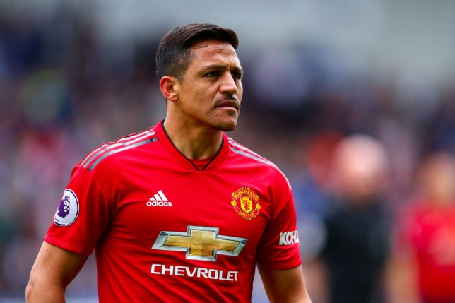 Alexis Sanchez watches on during Manchester United's game against Huddersfield Town