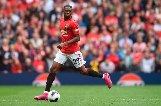 Manchester United right-back Aaron Wan-Bissaka runs with the ball against Chelsea