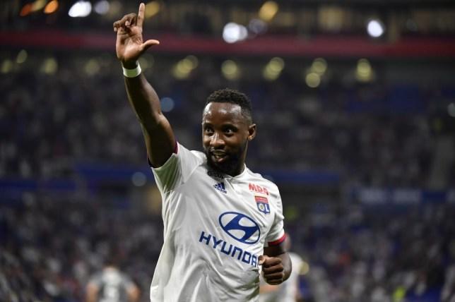 Moussa Dembele celebrates a goal for Lyon