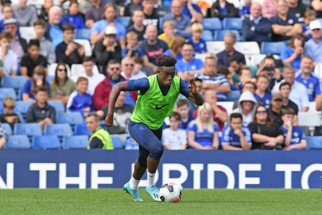 Callum Hudson-Odoi dribbles the ball during an open training session at Stamford Bridge