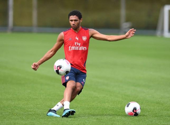 Mohamed Elneny kicks a ball during Arsenal training at London Colney