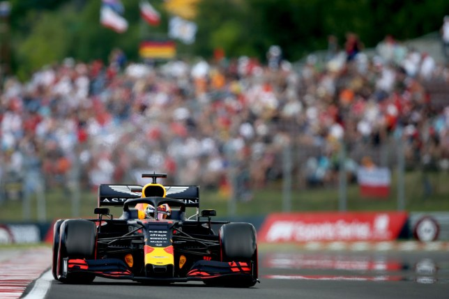 Max Verstappen driving the Aston Martin Red Bull Racing RB15 on racing track in Hungary