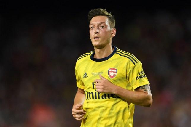 Mesut Ozil in action for Arsenal against Barcelona