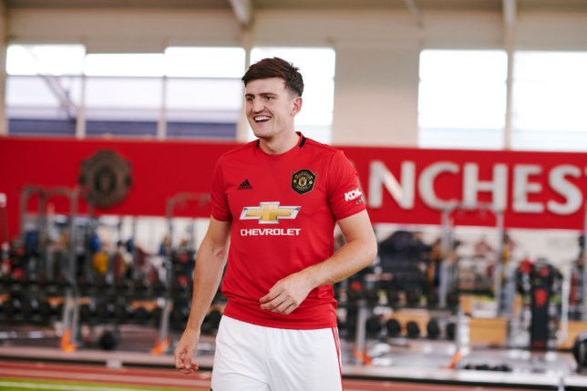 Harry Maguire posing in a Manchester United kit in the club's gym