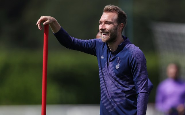 Christian Eriksen laughs during a training session at Hotspur Way