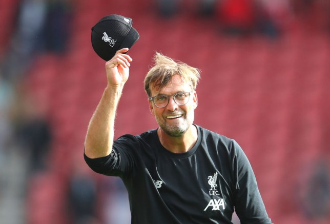 Jurgen Klopp salutes Liverpool supporters after his team's win against Southampton