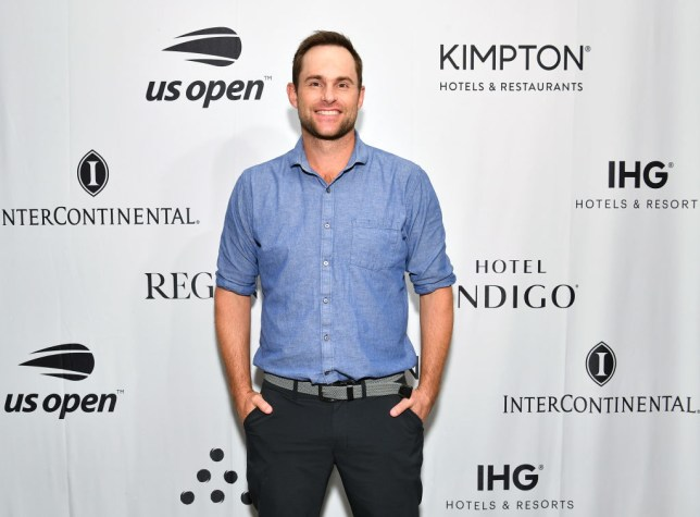 Andy Roddick stands hands in pockets on the red carpet in New York
