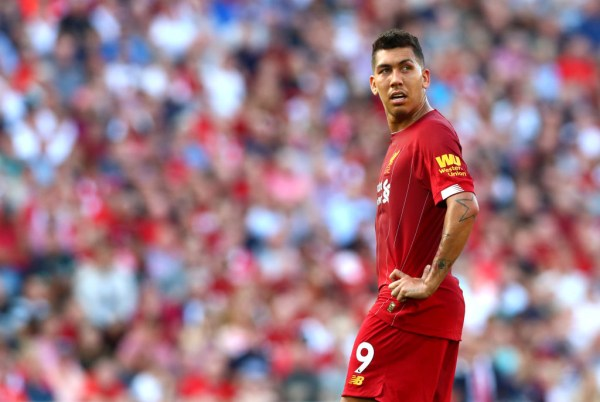 Roberto Firmino watches on during Liverpool's win over Arsenal