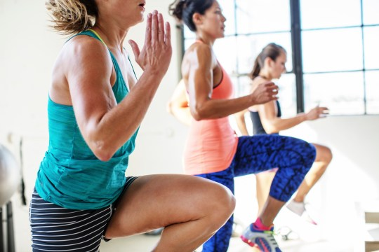 Female athletes jumping in health club