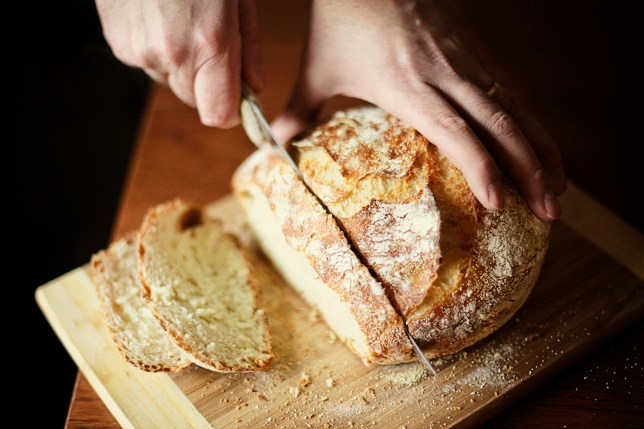 Cutting freshly baked bread.
