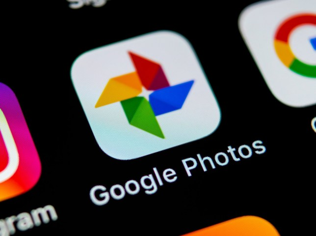 The Google Photos icon on a phone (Shutterstock)