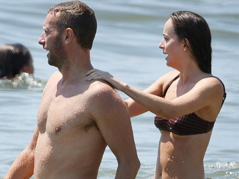 Dakota Johnson gets hands on with Chris Martin as two frolic in sea following 'split'