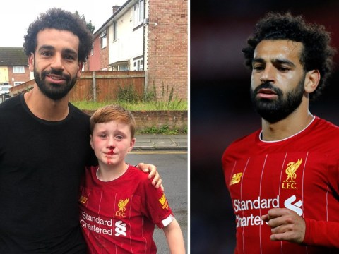 Liverpool's Mo Salah poses with boy who ran after him and crashed into lamppost