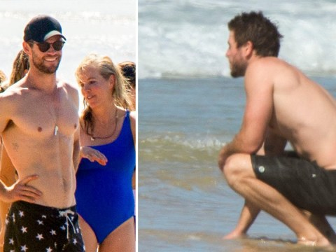 Chris Hemsworth has a blast as 'heartbroken' Liam looks mighty glum during beach day
