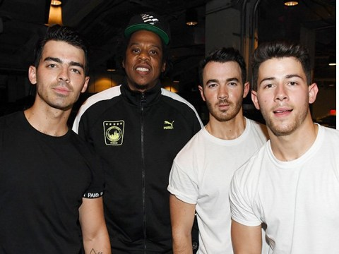 Jay-Z proves he's the Jonas Brothers' biggest fan as he's seen bopping along at their concert