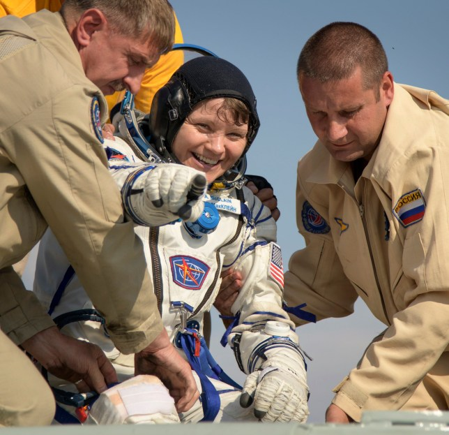 A handout photo made available by the National Aeronautics and Space Administration (NASA) shows Expedition 59 NASA astronaut Anne McClain (C) being helped out of the Soyuz MS-11 spacecraft just minutes after she, Canadian Space Agency astronaut David Saint-Jacques, and Roscosmos cosmonaut Oleg Kononenko, landed in a remote area near the town of Zhezkazgan, Kazakhstan, 25 June 2019. McClain, Saint-Jacques, and Kononenko are returning after 204 days in space where they served as members of the Expedition 58 and 59 crews onboard the International Space Station. EPA/BILL INGALLS / HANDOUT MANDATORY CREDIT: (NASA/Bill Ingalls) HANDOUT EDITORIAL USE ONLY/NO SALES