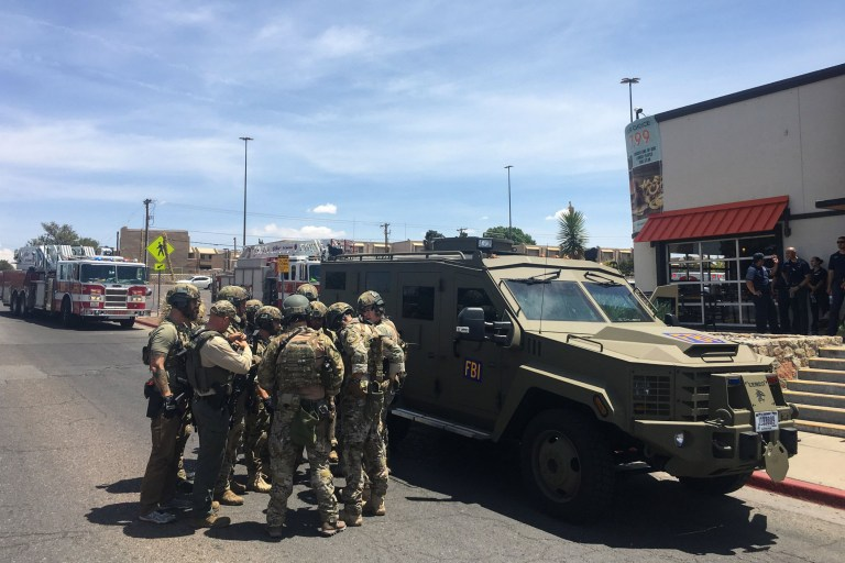 "Armed Policemen gather next to an FBI armoured vehicle next to the Cielo Vista Mall as an active shooter situation is going inside the Mall in El Paso on August 03, 2019. - Police said there may be more than one suspect involved in an active shooter situation Saturday in El Paso, Texas. City police said on Twitter they had received ""multi reports of multipe shooters."" There was no immediate word on casualties. (Photo by Joel Angel JUAREZ / AFP)JOEL ANGEL JUAREZ/AFP/Getty Images"