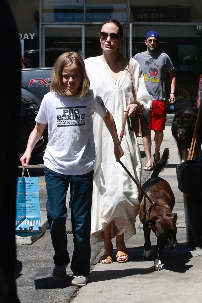 Los Angeles, CA - Angelina Jolie heads to the pet store with her daughter and their dog. Angelina stands out in a long white dress for the outing. Pictured: Angelina Jolie BACKGRID USA 4 AUGUST 2019 USA: +1 310 798 9111 / usasales@backgrid.com UK: +44 208 344 2007 / uksales@backgrid.com *UK Clients - Pictures Containing Children Please Pixelate Face Prior To Publication*