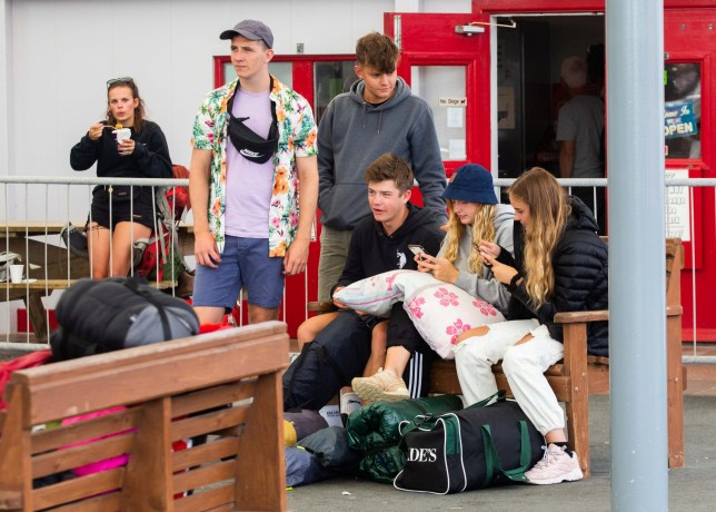 Festival goers wait at the Newquay Train Station