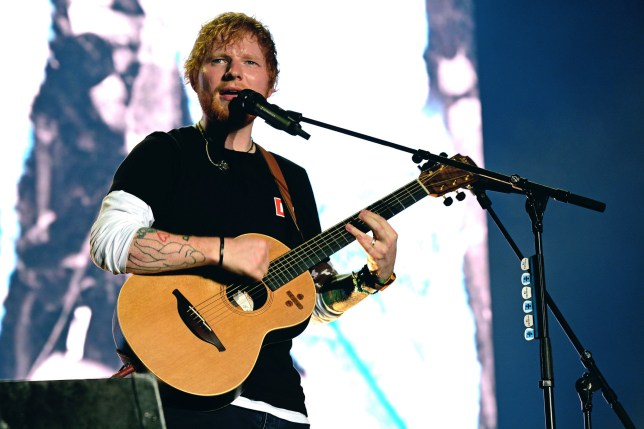 Ed Sheeran performing on tour