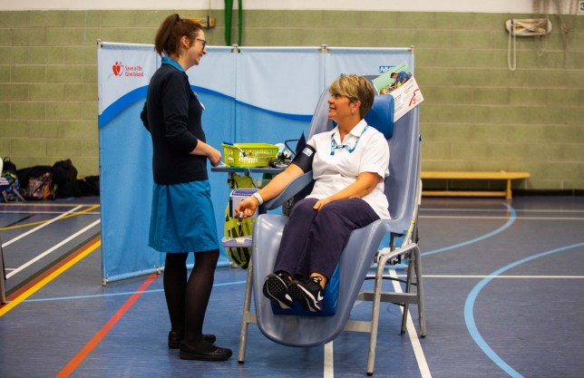 **EMBARGOED UNTIL 2PM BST / THURSDAY 8 AUGUST, 2019** Sue Olds gives blood at the Penzance Leisure Centre in Cornwall. Meet the woman who has saved countless lives - because she has the rarest BLOOD type in Britain - and is its ONLY donor. See SWNS story SWPLblood. Sue Olds, 52, has the incredibly rare blood-type -D- and is the only donor of her kind registered with the NHS. There are only 110 people in the world with the blood type - and 88 of those live in Japan. It makes Sue's 46 donations so far especially valuable to the NHS - who have used it to save many lives including a baby. They also take her blood to freeze for future use when anyone else with -D- are in need. The NHS Blood and Transplant say if she continues to donate during her lifetime she'll have saved or improved a HUNDRED lives. Sue, a support from Penzance, Cornwall, said she will continue donating as often as possible.