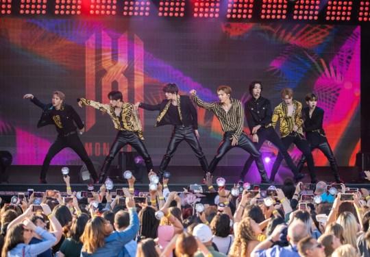 Members of k-pop group monsta x performing on jimmy kimmel