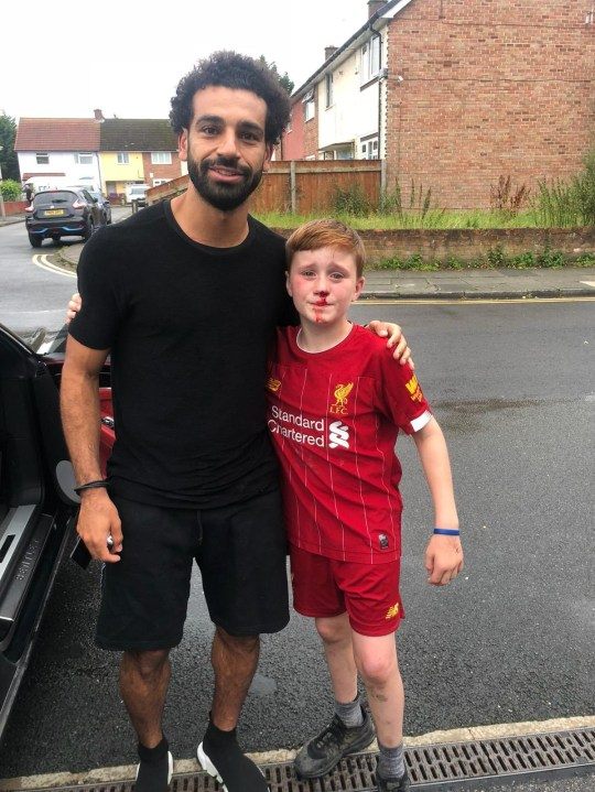 A young Liverpool fan who knocked himself out after running into a lamppost while trying to wave at Mo Salah got the shock of his life - when the Egyptian striker turned up at his door to see if he was alright. Louis Fowler, 11, and his 10-year-old brother Isaac were waiting outside the Reds' Melwood training ground yesterday afternoon [Aug 10] hoping to catch a glimpse of their heroes as they left. Caption: Liverpool forward Mo Salah pictured with 11-year-old Louis Fowler, who ran into a lamppost while trying to get the Egyptian's attention outside the club's Melwood training ground