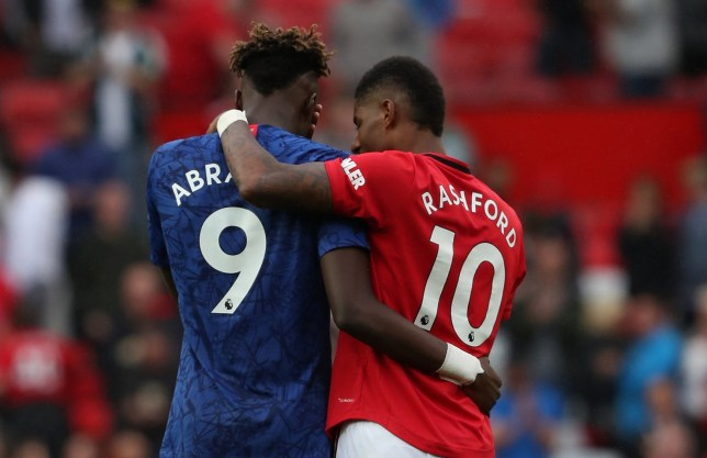 Marcus Rashford of Manchester United speaks to Tammy Abraham of Chelsea after the Premier League match between Manchester United and Chelse