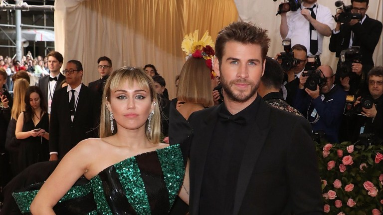 """NEW YORK, NY - MAY 06: Miley Cyrus and Liam Hemsworth attend the 2019 Met Gala celebrating """"Camp: Notes on Fashion"""" at The Metropolitan Museum of Art on May 6, 2019 in New York City. (Photo by Taylor Hill/FilmMagic)"""