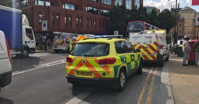 Emergency services are currently dealing with an incident in the Wimbledon area in which a person has been killed by a train, which is causing disruption to services. According to National Rail's website, trains may be delayed or cancelled until approximately 10pm this evening (August 13). There are four ambulance vehicles, two fire engines and air ambulance crews at the scene, as well as British Transport Police vehicles. The incident is having a knock-on effect to services in Surrey, with services departing from among those Guildford showing as delayed. CAPTION Emergency services outside Wimbledon station on August 13