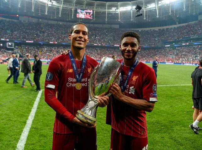 Virgil van Dijk and Joe Gomez celebrate Liverpool's Super Cup victory over Chelsea