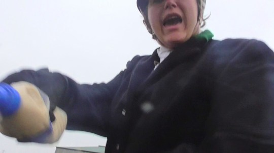 PIC FROM Kennedy News and Media (PICTURED: JULIE HADLOW, 51, OF KENT, WAS FILMED SQUIRTING FOX URINE AND WATER IN THE FACE OF A 64-YEAR-OLD HUNT SAB KNOWN AS 'UNCLE BOB') This is the moment a fox hunter squirted fox 'piss' in an elderly protester's face - reportedly leaving him sick and needing blood tests. Footage shows Julie Hadlow of Ashford Valley Tickham Hunt squirting the bottle of yellow fox urine in the face of a West Kent Hunt Sabs protester after he questioned their hunting methods. The 64-year-old victim, known only as 'Bob', can be heard asking what the hunters had used to lay a scent, to which self-employed Julie can be heard replying 'piss'. SEE KENNEDY NEWS COPY - 0161 697 4266