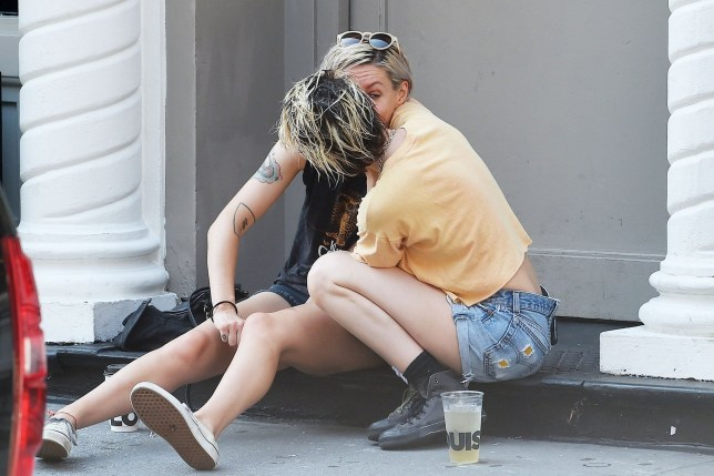 """New York, NY - *EXCLUSIVE* - Kristen Stewart passionately kisses writer Dylan Meyer on a NYC stoop during an afternoon out. The """"Charlie's Angels' star appeared over the moon with her new leading lady. Stewart was spotted locking lips in July with ex Stella Maxwell in Italy. Pictured: Kristen Stewart BACKGRID USA 15 AUGUST 2019 USA: +1 310 798 9111 / usasales@backgrid.com UK: +44 208 344 2007 / uksales@backgrid.com *UK Clients - Pictures Containing Children Please Pixelate Face Prior To Publication*"""