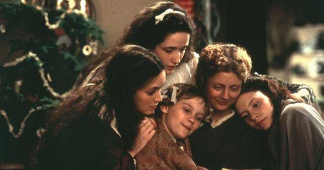 A scene from the 1994 movie adaption of Little Women where Mrs March (Susan Sarandon) is sat surrounded by her daughters Jo (Winona Ryder), Meg (Trini Alvarado), Amy (Kirsten Dunst) and Beth (Claire Danes)