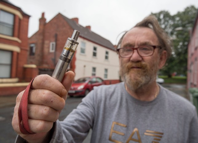 Taxi driver Chris Jones, from Birkenhead, who has accused the council of holding a grudge and denying him the chance to renew his license after he successfully won an appeal against controversial litter firm Kingdom. The 63-year-old had been issued a fine for smoking in his cab despite the fact he uses a e-cigarette. Photo by James Maloney