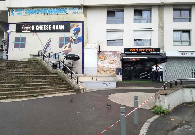 """Policemen stand in front of the eatery where a waiter was shot dead by a customer allegedly angry at having to wait for a sandwich, in the eastern Paris suburb of Noisy-le-Grand on August 17, 2019. - The gunman, who witnesses said lost his temper """"as his sandwich wasn't prepared quickly enough"""" for his liking, fled the scene. Police have opened a murder investigation. (Photo by Tiphaine LE LIBOUX / AFP)TIPHAINE LE LIBOUX/AFP/Getty Images"""