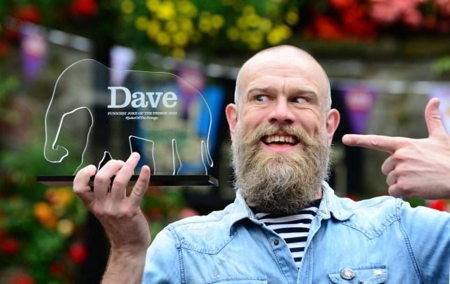 Comedian Olaf Falafel holds up his Dave award for Best Joke