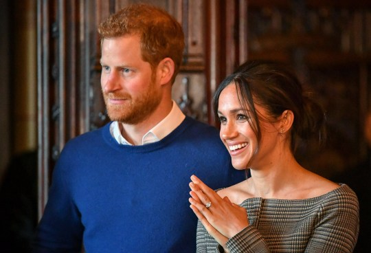 CARDIFF, WALES - JANUARY 18: Prince Harry and Meghan Markle watch a performance by a Welsh choir in the banqueting hall during a visit to Cardiff Castle on January 18, 2018 in Cardiff, Wales. (Photo by Ben Birchall - WPA Pool / Getty Images)