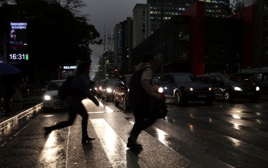 Overcast and dark sky at Paulista Avenue, in Sao Paulo, Brazil, on the afternoon of August 19, 2019, with cold and light rain. Photo: JF DIORIO/ESTADAO CONTEUDO (Agencia Estado via AP Images)