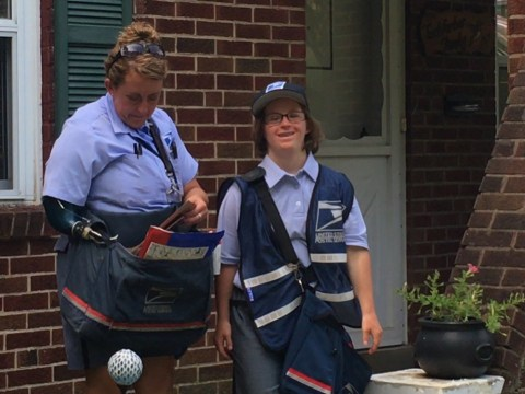 Woman with Down's Syndrome completes her dream of being a mail carrier