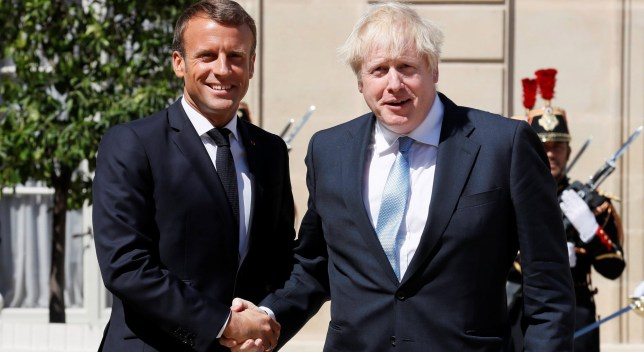 French President Emmanuel Macron welcomes British Prime Minister Boris Johnson before a meeting on Brexit at the Elysee Palace in Paris, France, August 22, 2019. REUTERS/Gonzalo Fuentes